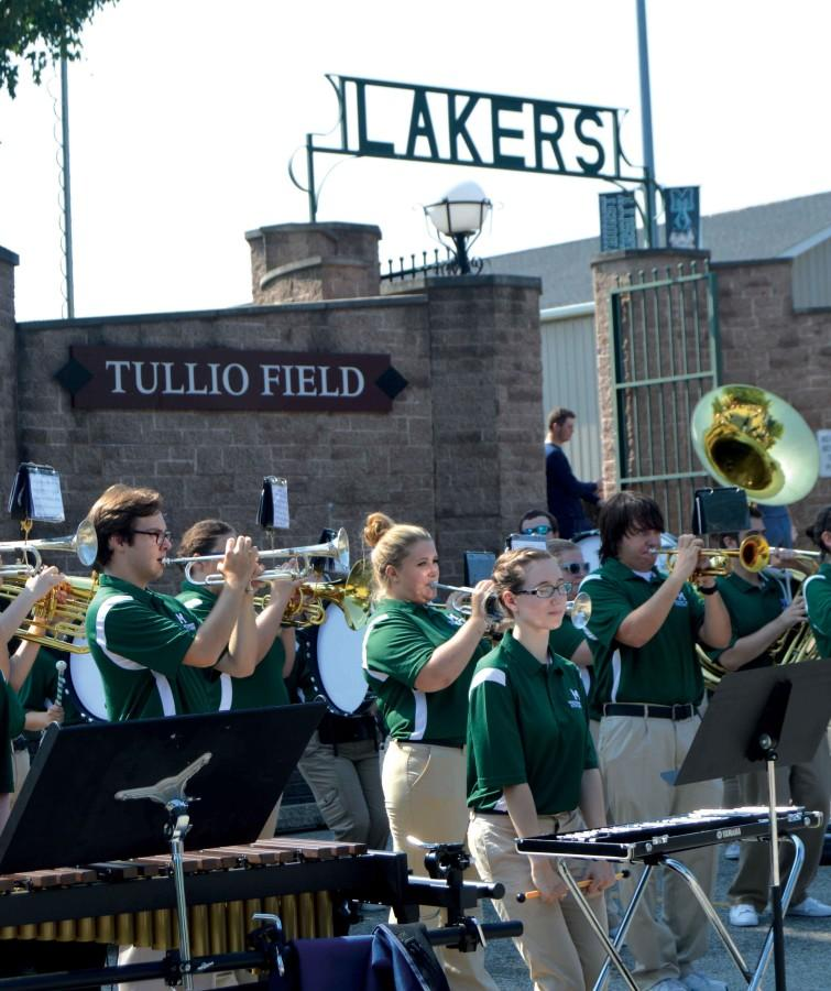 The+Mercyhurst+athletic+band+amps+up+school+spirit+at+a+tailgate+before+last+Friday%E2%80%99s+football+game.+%0AThe+athletic+band+also+performs+the+National+Anthem+and+Mercyhurst%E2%80%99s+alma+mater+before+the+football+game+begins.+