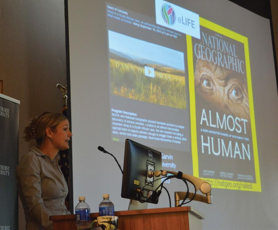 Heather Garvin, Ph.D., presents the National Geographic cover featuring ancient bones, Homo naledi