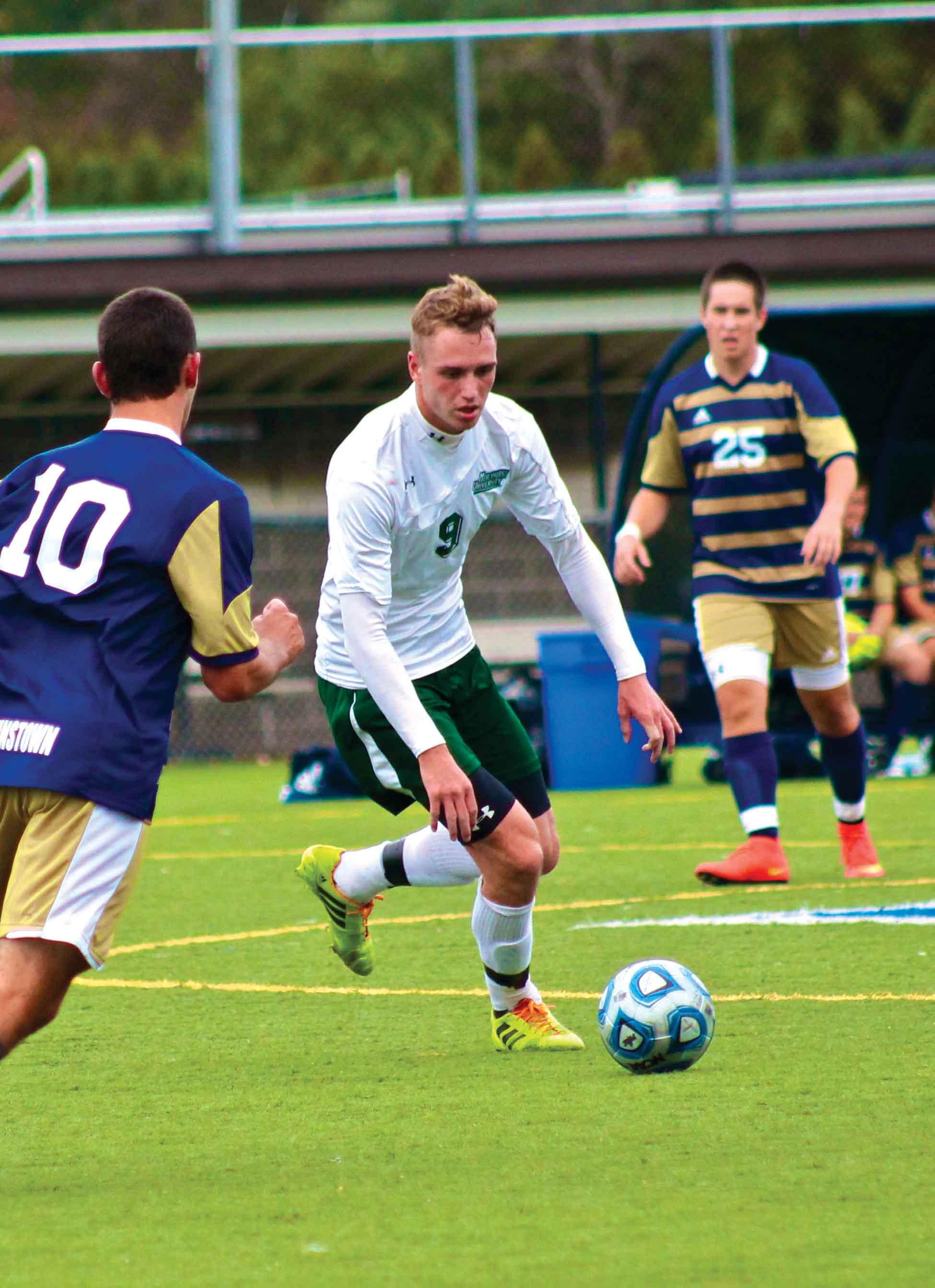 Without last season's leading scorer, Jack Watson (9), the men's soccer team is suffering a setback this season.