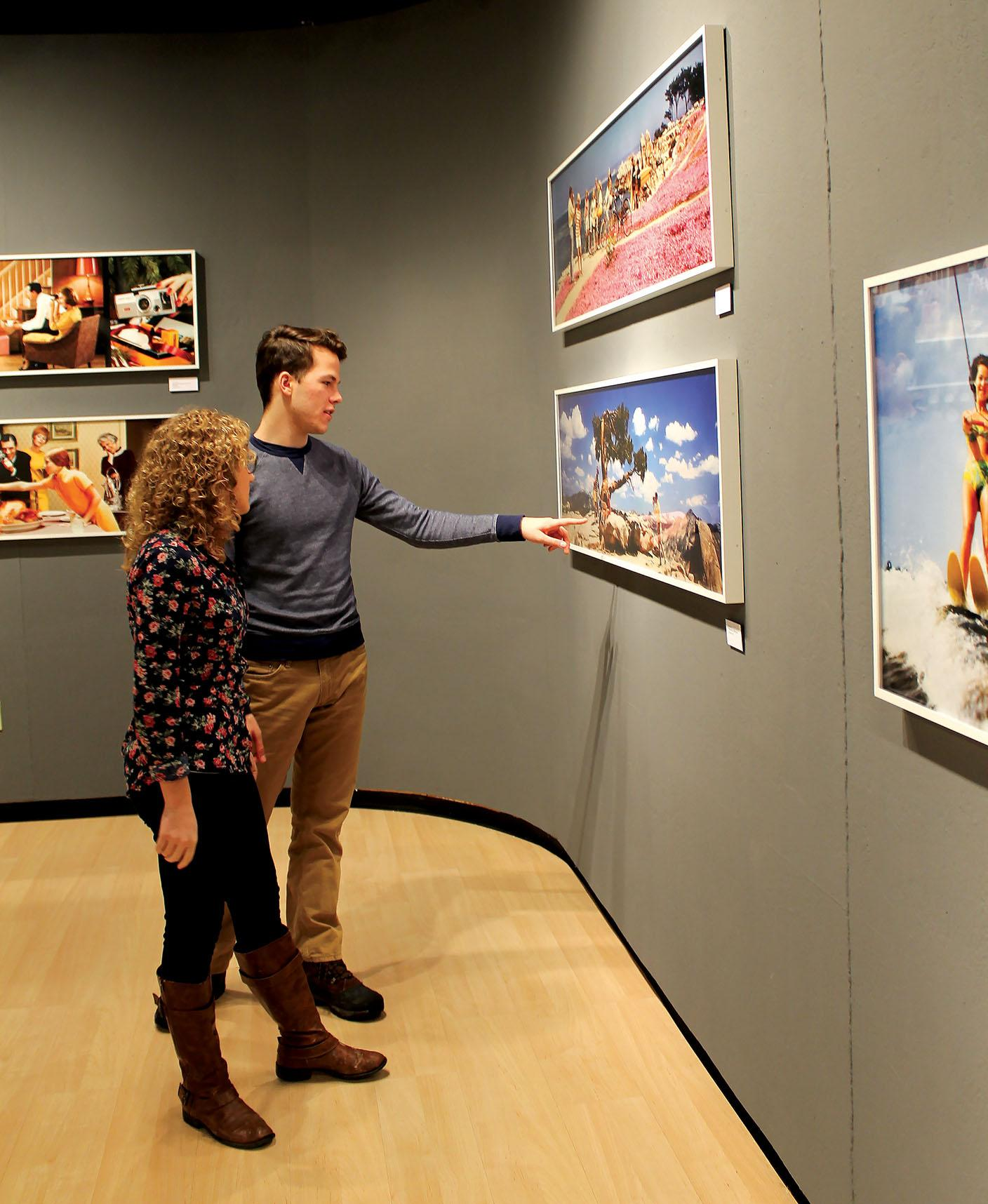Sophomore Charity Ludwig and freshman Cole Prots look at the Colorama Exhibit in the Cummings Art Gallery.