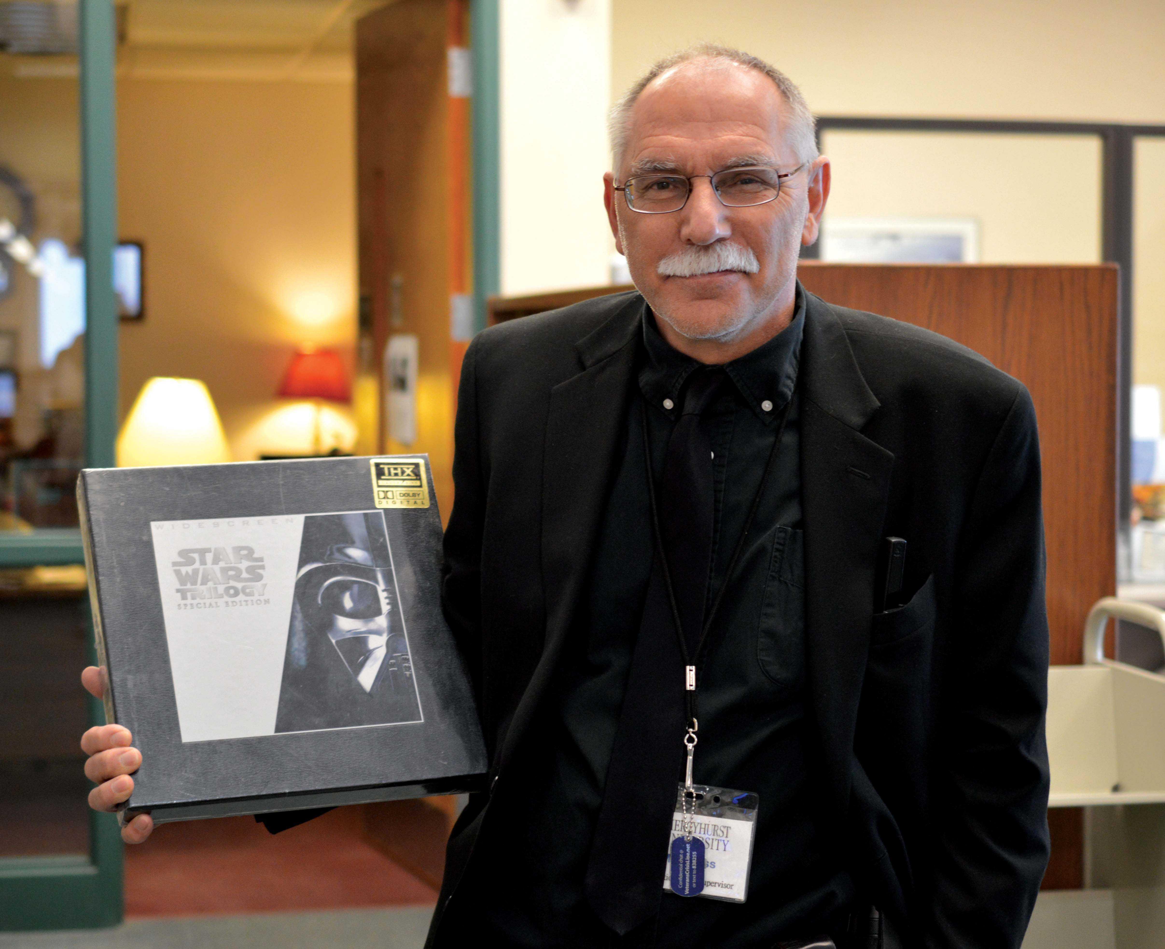 Librarian Joseph Kloss holds the Star Wars Laserdisc.