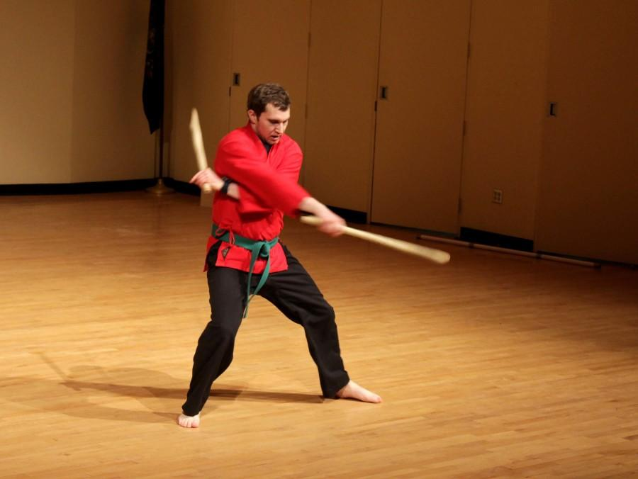 """Jacob Podyman performs a  martial arts' """"kata"""" in the Walker Recital Hall.  Through the martial arts club, Podyma hopes to teach students to become a better version of themselves."""