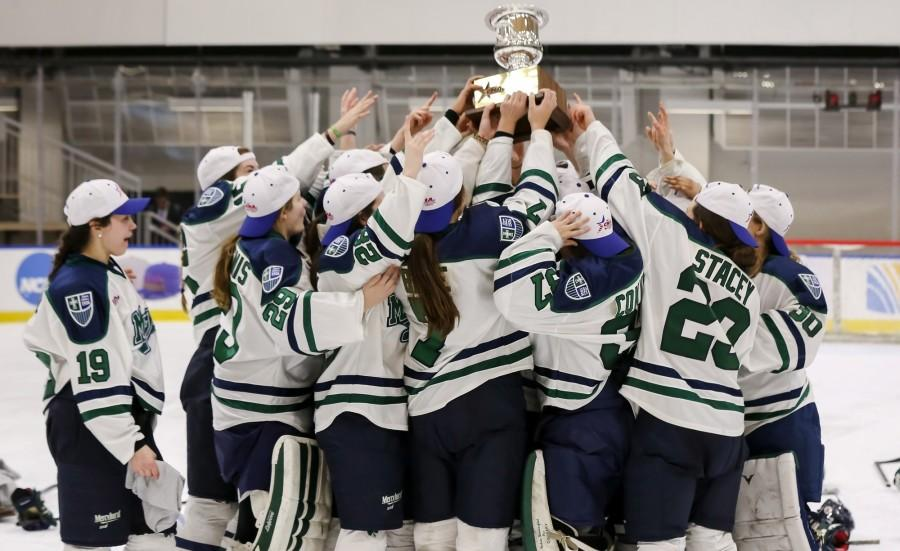 The Mercyhurst women's hockey team celebrates after winning the CHA championship game, 4-3, in overtime over Syracuse.