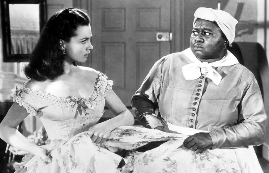 """Hattie McDaniel (right) performs as """"Mammy"""" in """"Gone with the Wind"""" alongside Vivien Leigh in 1939."""