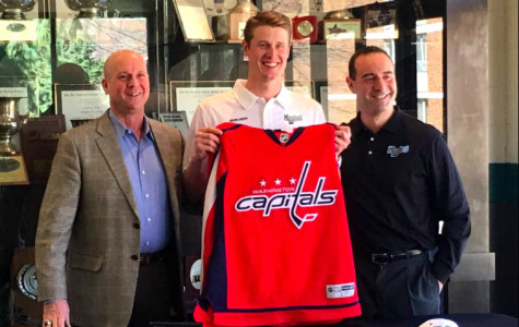 Adam Carlson signs with Capitals