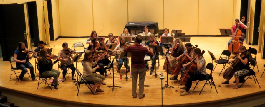 Joseph Kneer, D.M.A., one of the directors of the Chamber Orchestra directing during rehearsal.