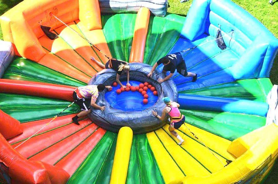 "Students play a real-life game of ""Hungry, Hungry Hippo"" on one of many giant inflatables set up across campus."