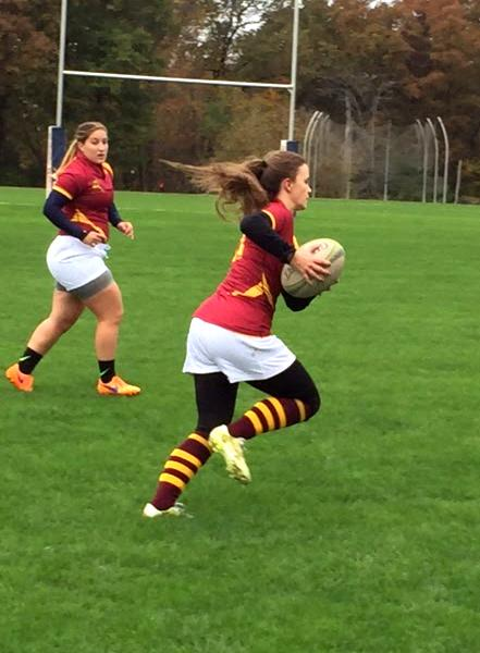 Hannah Mayes, Mercyhurst junior and a first-time rugby player, takes the ball.