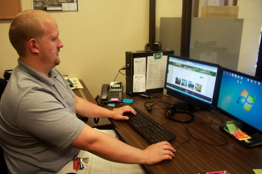 Matthew Shellenberger, academic library computer support specialist, works on updating the library website.