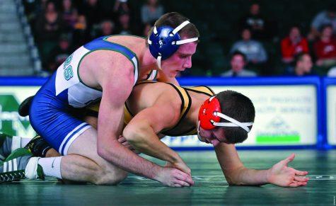 MU wrestling champions the mats