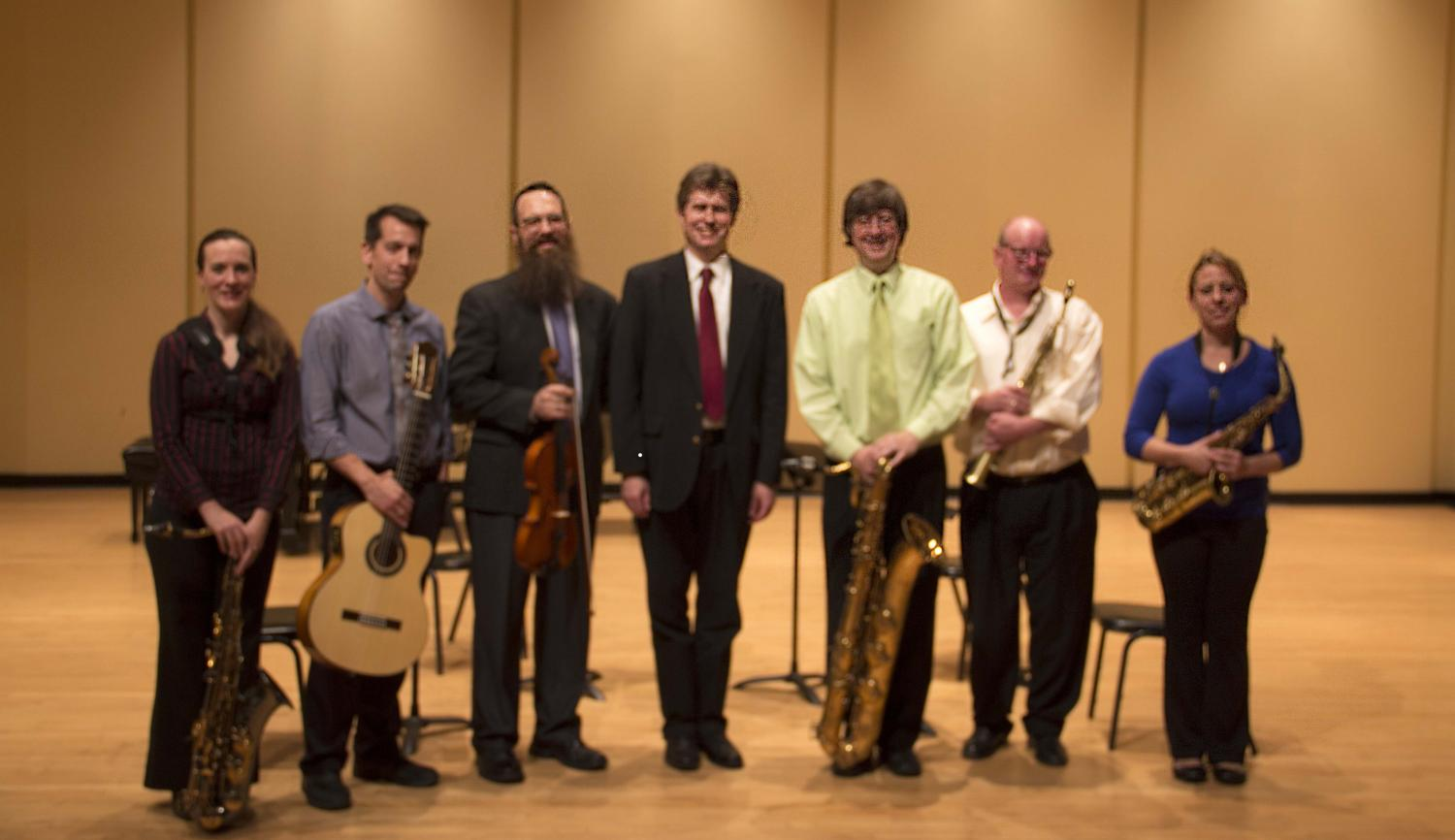 From left to right: Music faculty members Rebecca Wunch, Jonathan Nolan, Jonathan Moser, Nathan Hess, D.M.A., Scott Meier, Ph.D., Allan Zürcher and Bethany Dressler all performed at the recital.
