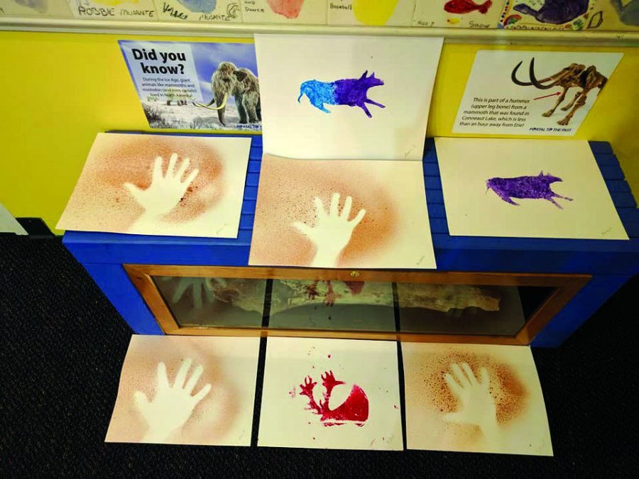 Children at Experience Children's Museum got to make hand artwork that resembled cave drawings.