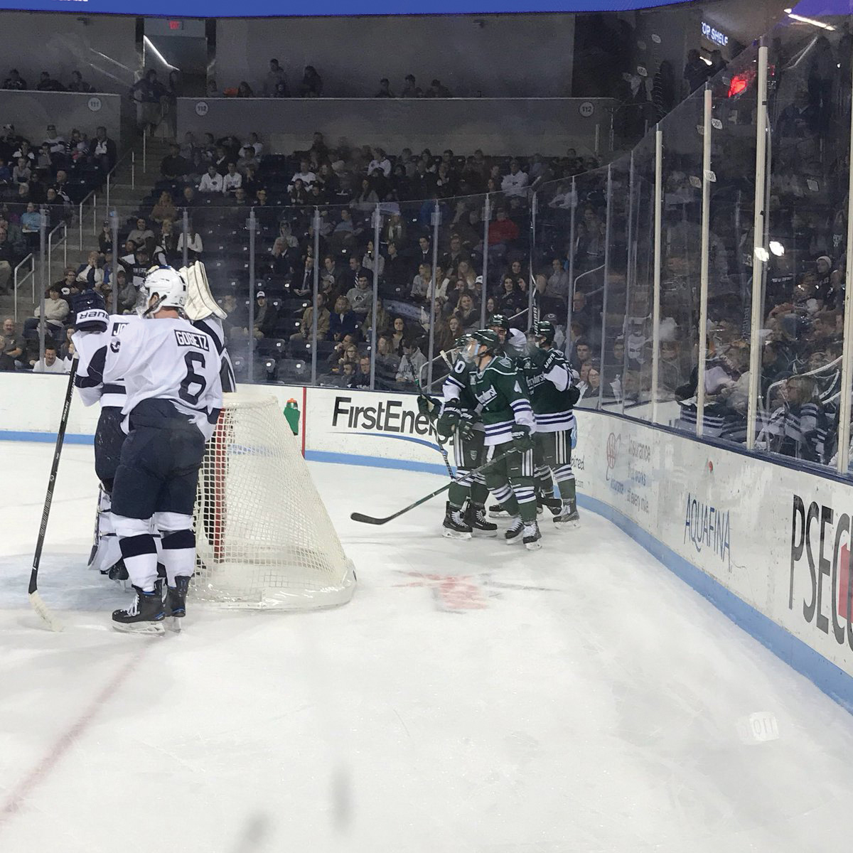 Lakers huddle behind the Penn State net.  The Lakers won 7-4 against Penn State on Nov. 3