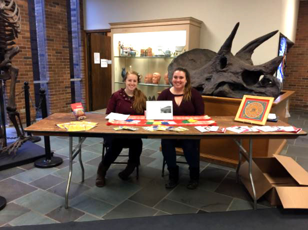 Kaitlyn Kirchmeir and Julia Detota, both sophomore Art Therapy and Psychology double majors, sell cards and prayer flags in Zurn to help raise funds for a trip to work with children in Nepal.