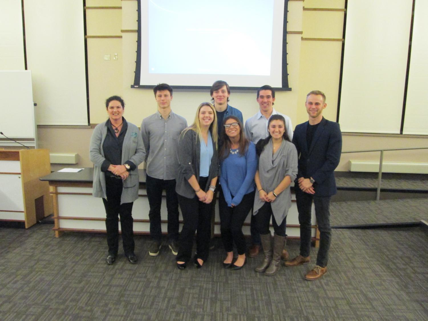 From left, financial adviser Joellen Nelson poses with Laker Asset Management club members Arseniy Sklyarov, Cleary Johnson, Garek Schultz, Gabrielle Procter, Jeremy Wu, Breanna Mysyk and Adrian Larsen.