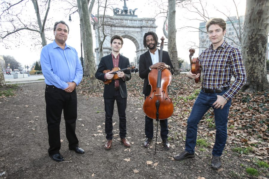 From left to right: David Balakrishnan, violin, Alex Hargreaves, violin, Malcolm Parson, cello, and Benjamin Von Gutzeit, viola will perform as Turtle Island Quartet at Mercyhurst on March 15.