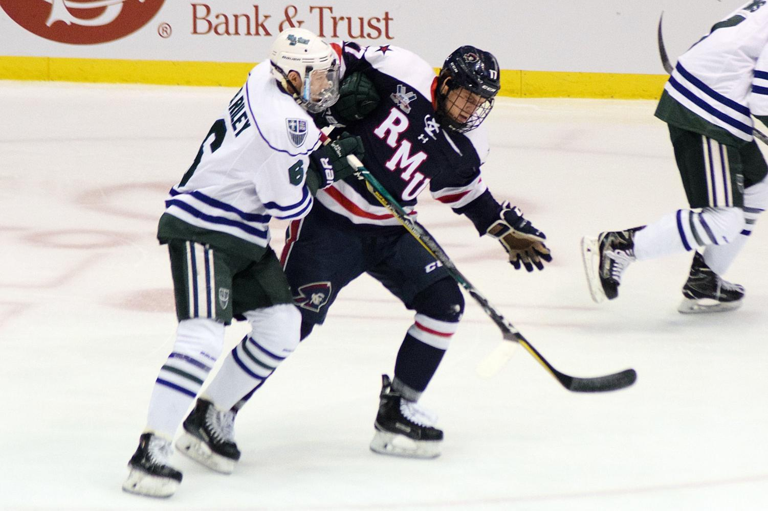The Lakers' Jack Riley battles with Robert Morris'Brandon Watt.