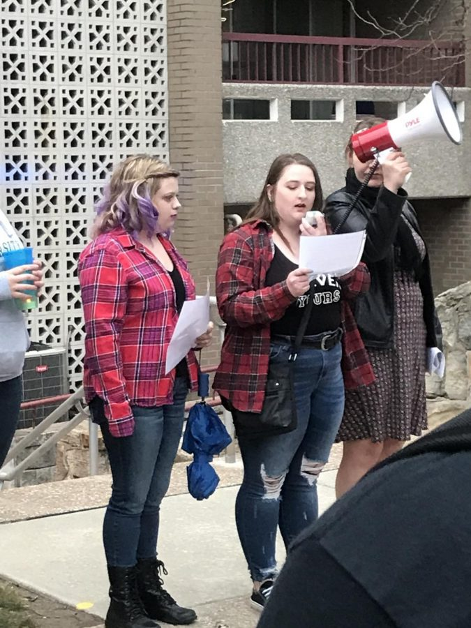 Kay Mattena, far left, junior Anthropology/Archaelogy major; Sarah Wright, left, senior Psychology major; and Alyssa Jaeger, right, sophomore Criminal Justice and Psychology double major, spoke during the march.