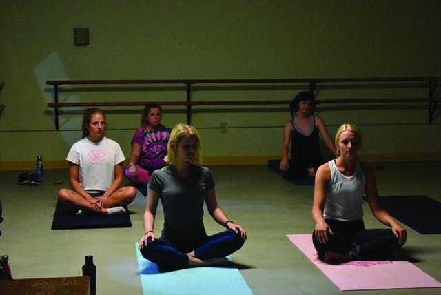 Students+participate+in+a+yoga+class+run+by+Dance+major+Niusha+Karkehabadi.