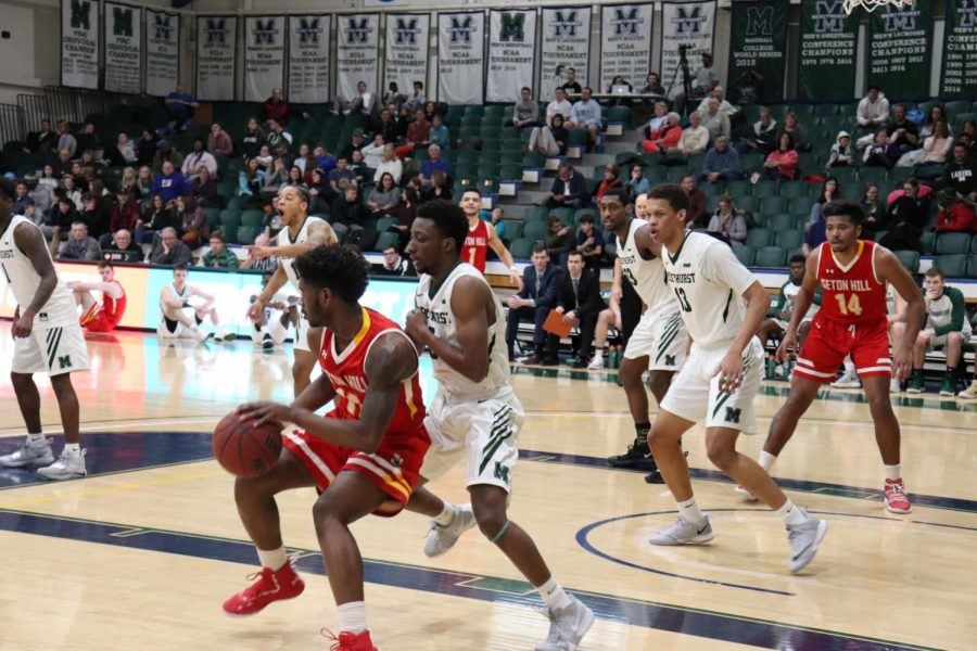 No. 0 MiyKah McIntosh guards against Seton Hill on Saturday, while  No. 13 Edvaldo Ferreira and No. 33 Patrick Smith guard the paint.  The Lakers won against the Griffins 82-58.