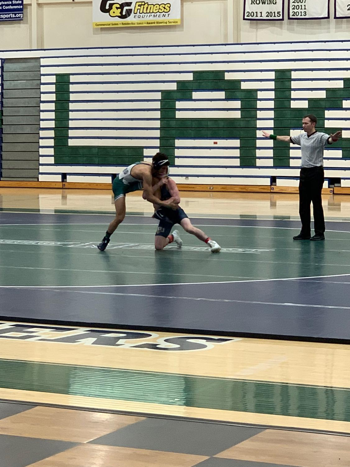 Mercyhurst's Alexis Soriano grapples with Matthew Siszka of Pitt-Johnstown.  The Lakers fell 9-30 against the Mountain Cats, but were victorious 30-12 against University of Findlay for Senior Day.