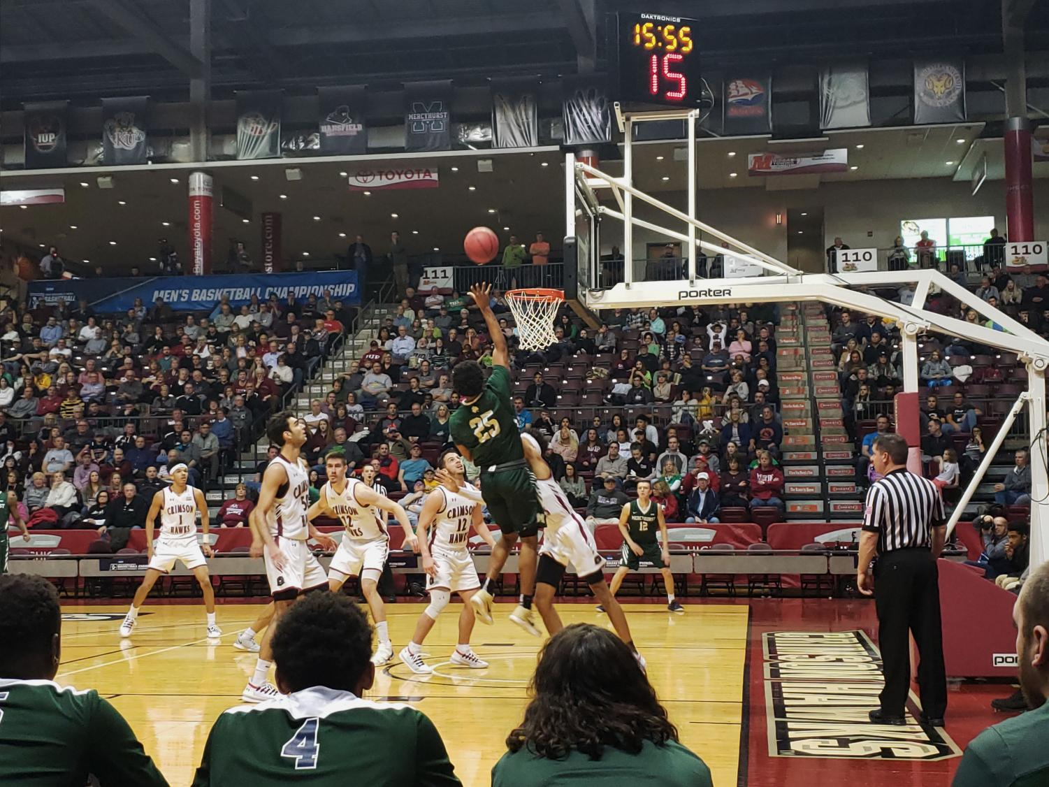 The Lakers' Jason Massey jumps for a shot against Indiana University of Pennsylvania on March 17.