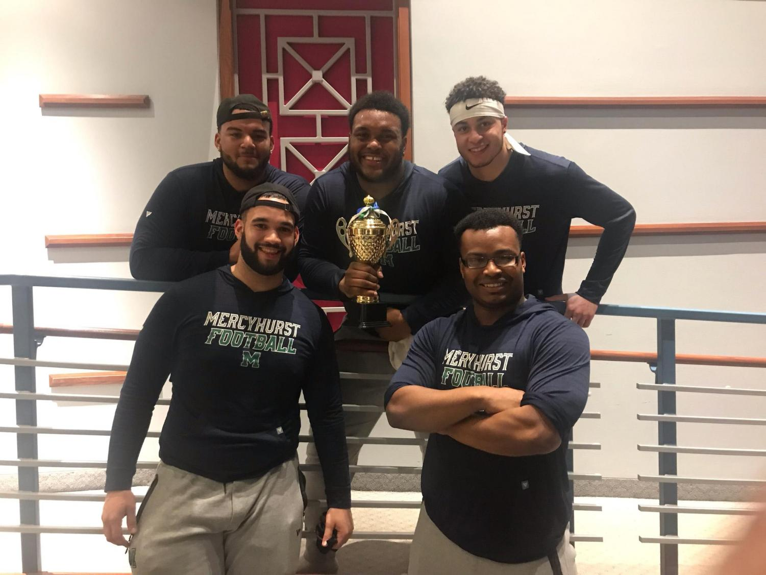 The first place winning football team posed for a photo afterwards.  From left to right, front to back: Freddy Pantaleon, Donny Bryant III, Ayron Thompson, JaKarri Buckner and Qadry Ismail.