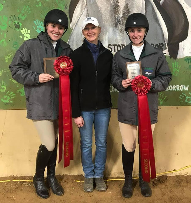 From left, sophomore Hunter Reiff, Equestrian team coach Halli Bidwell and junior Alyssa Reedy pose, with both riders displaying their respective awards for this season.