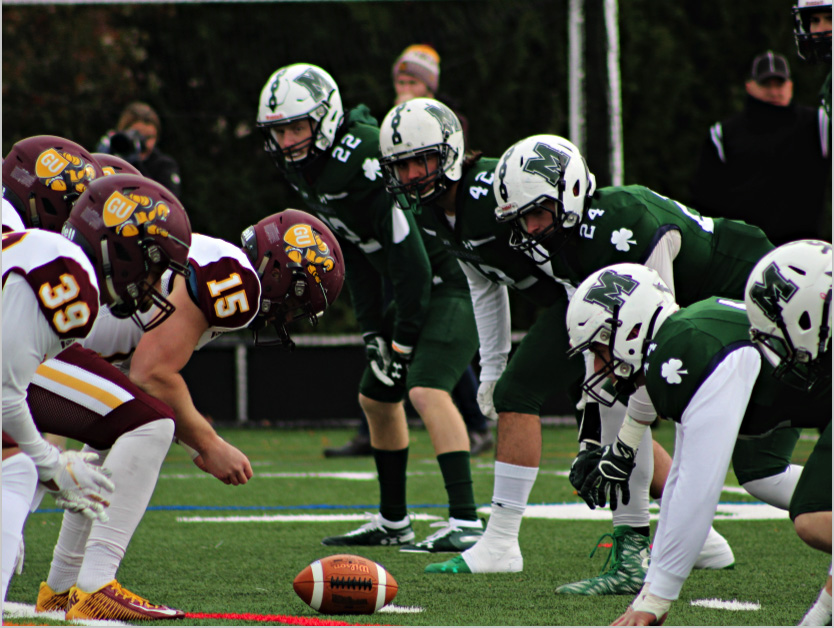The Mercyhurst defensive line prepares for Gannon to snap the ball during Saturday's game. A strong defensive showing shut down Gannon's offensive productivity, resulting in a 28-7 Mercyhurst victory.