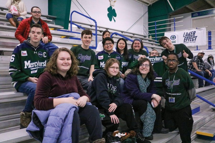Students in the AIM program and faculty show their Laker Pride by supporting the women's hockey team against Penn State.