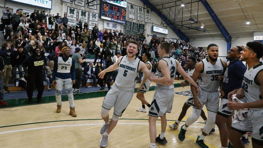Mercyhurst University's No. 5 Trystan Pratapas celebrates with the team after his game-winning three-pointer seconds before the final buzzer.