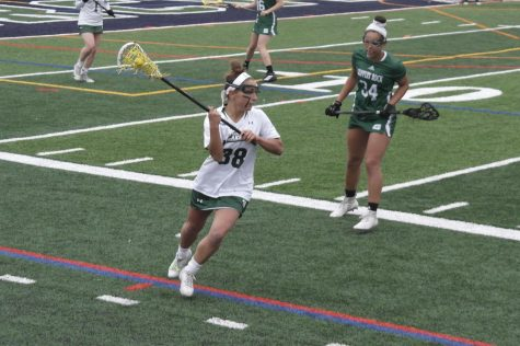 Sophomore midfielder No. 38 Marissa Comerate attacks against Slippery Rocks No. 34 Shayanne Toom