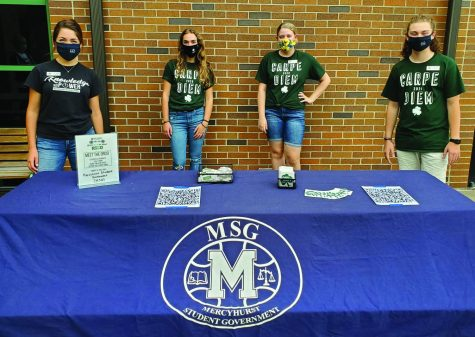 (Left to right) MSG President Lucy Belleau, Vice President Sarah Klein and MAC/SAC programmers Chloe Sanfratello and Joey Franz talked to interested students about joining the Mercyhurst Student Government. Besides giving out helpful information, the four also passed out free Mercyhurst stickers, spirit t-shirts, and playing cards.