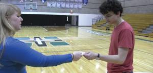 "Contributed photo: Freshman Tonya Lenhart and sophomore Jeffrey Krull exchange a note to help pay it forward in ""100."""