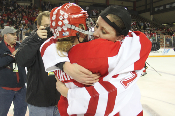 Ethan Magoc photo: Boston University and Wisconsin captains Holly Lorms (left) and Meghan Duggan embrace at center ice following the NCAA championship game on Sunday, March 20, 2011 at Tullio Arena.