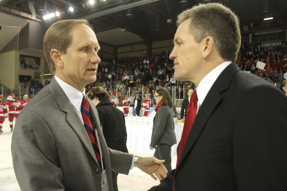 Ethan Magoc photo: Boston University coach Brian Durocher (left) and Wisconsin coach Mark Johnson shake hands after the NCAA championship game on Sunday, March 20, 2011 at Tullio Arena.