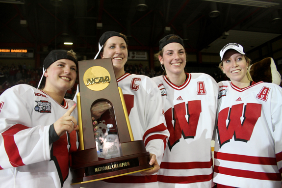 Ethan Magoc photo: Wisconsin captain  Meghan Duggan (center left) and assistant captains Geena Prough, Hilary Knight and Mallory DeLuce stand with the NCAA championship trophy on Sunday, March 20, 2011 at Tullio Arena.