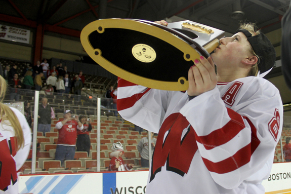 Ethan Magoc photo: Wisconsin assistant captain Geena Prough kisses the NCAA championship trophy on Sunday, March 20, 2011 at Tullio Arena.