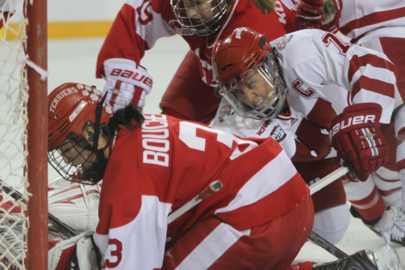 Ethan Magoc photo: Wisconsin's Meghan Duggan (7) crashes the net during the first period against Boston University on Sunday, March 20, 2011 at Tullio Arena.