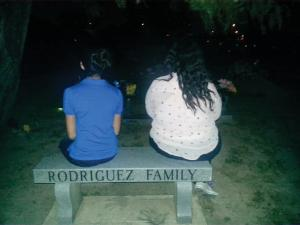 Contributed photo: Rodriguez's two nieces sit at a memorial dedicated to his brother who lost his life from an act of police brutality.