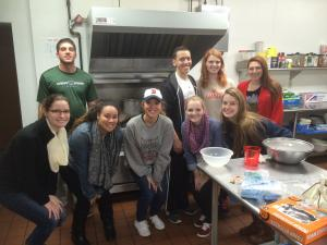 Contributed photo: Students from a Christology class taught by Mary Hembrow-Snyder, Ph.D., took part in a Service Learning project at the end of October. The class served dinners to between 25 to 30 residents at the Emergency Shelter and the Lodge on Sass.