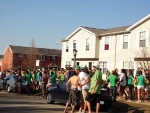 Jill Barrile photo: Students on Lewis Avenue celebrate St. Patrick's Day.