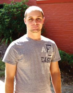 Zach Dorsch photo:: Junior Brady Greenawalt enjoys riding a unicycle, a unique hobby for a college student.
