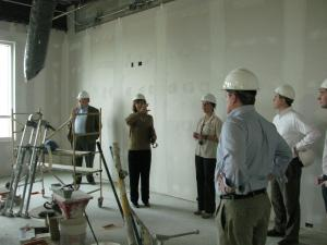 Staff photo: Architect Sherry Buehler gives the political science faculty a tour of the academic building.