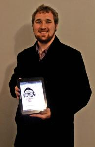 "Bowe photo: Wheaton holds his published eBook, ""The Poor Man's Guide to Weird and Unusual Video Games."""
