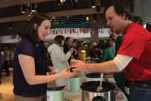 Ethan Magoc photo: WMCE Station Director Mike Leal, right, hands Sports Information Director Lauren Packer Webster a cup of chili on Wednesday, Feb. 2, at the Student Union.