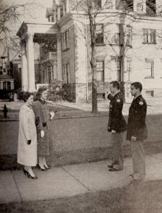 Merciad file photo: ROTC seniors at Gannon College, Ted White and Mike Annunciata, show Mary Kay Walsh and Mary Ann Bittner, junior and senior students of Mercyhurst, the recently purchased Student Union Building. This Student Center, located on the corner of 6th and Walnut Streets, is to be furnished partially by the proceeds of the forthcoming Christmas Carnival, to be held in Gannon Audi, December 14, 15 and 16.