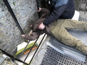 Mayher kissing the Blarney Stone for eloquence.
