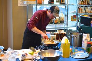 """Casey Bleuel photo: Junior Timothy Gilbert puts together a dish at this year's Mercyhurst edition of """"Chopped."""" The proceeds from the event went to the Autism Society of Northwestern Pennsylvania."""