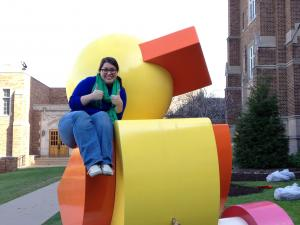 Danielle Vaccaro photo: Caitlin Handerhan has a great time bonding with the art on the front lawn of our campus.